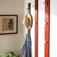 Clear up entryway clutter with a simple coat and hat rack that you can build in about an hour. Use the types of hooks that fit the items you want to hang.