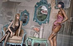 Lingerrie Shop Window, a photo by shadow play The right props (furniture and mannequins) make all the difference in this display Shop Window Displays, Store Displays, Display Window, Fashion Merchandising, Visual Merchandising, Lingerie Store Design, Shop Fronts, Vintage Lingerie, Cabinets