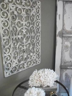 I MUST DO THIS!!!!! How amazing does this look for so little time and money?!  Create a vintage iron piece for your wall. You'll need black outdoor rubber door mats, white spray paint and some sanding paper.  Just spray paint the rubber doormats and after they are completely dry, sand them here and there to give them an aged feel.   #DIY #Decor (Source: salvagedior.com)