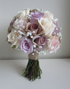 Lilac Amnesia Roses with lilac Ocean Song roses and baby's breath , gypsophilia Brides Bouquet Hand tied