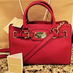 NWT Michael Kors Red Hamilton bag New with tag! Still in its shopping bag ......Offers welcome bundle deal not included. Trade value more Michael Kors Bags Crossbody Bags