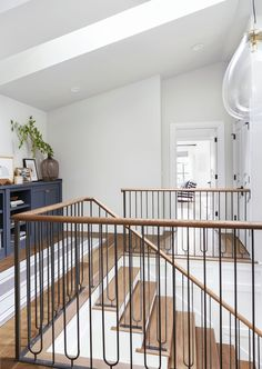 Portland Reveal: You'll Never Guess What This Bookcase Is Hiding. - Emily Henderson Traditional upstairs hallway with console table and runner rug and iron staircase railing Iron Staircase Railing, Modern Staircase, Staircase Design, Replace Stair Railing, Modern Stair Railing, Modern Hallway, Wrought Iron Stairs, Metal Railings, Bannister