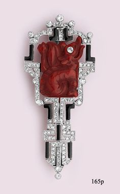Art Deco / Carved cinnabar dragon, enamel,  diamond and platinum brooch.LaCloche Frères, Paris.