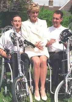May 13, 1996: Princess Diana, patron of the International Spinal Research Trust pictured with two athletes during the launch of the wheelchair marathon organized by the charity Push 2000 to raise money for spinal research.