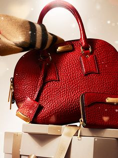 Iconic Burberry gifts - The Orchard bag in military red grain leather and check cashmere scarves from Burberry