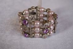 Brede armband met elastiek en glinsteringen zilver, roze parelkleur, paars