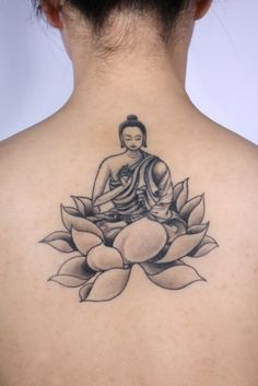 Black & Grey Buddha in lotus flower tattoo. Inked by Yoni Zilber of NY Adorned Studio.