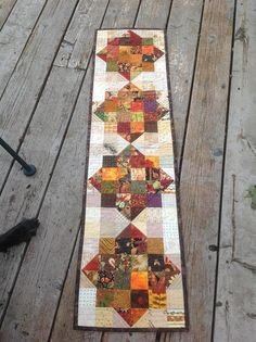 Autumn Medallions 12x48 quilted table runner in fall colors