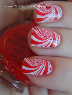 Christmas candy nail art- this looks like a water marble worth trying. (: