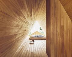 Th bedroom space is backlit by a unique A shape that provide ample natural light—reflecting the cedar's warm tones.