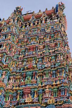 Meenakshi Amman Temple [also called: Meenakshi Sundareswarar Temple, Tiru-aalavaai and Meenakshi Amman Kovil] is a historic Hindu temple located on the southern bank of the Vaigai River in the temple city of Madurai, Tamil Nadu, India.