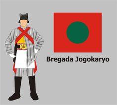BREGADA PRAJURIT JOGOKARYO    Selanjutnya tampil Bregada Prajurit Jogokaryo. Ciri Bregada Prajurit Jogokaryo adalah seragam berbentuk sikepan dan celana bercorak lurik khas Jogokaryo dengan rompi kuning emas, sepatu pantopel hitam dengan kaos kaki biru tua serta topi hitam bersayap. Benderanya bernama Papasan, dengan dwaja bernama Kanjeng Kyai Trisula. Bregada ini dilengkapi dengan perangkat musik tambur, seruling, dan terompet, yang melagukan Tameng Madura dan Slagunder.