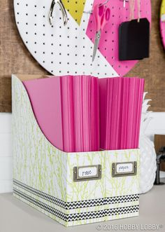 When it comes to organizing, keep it sophisticated and stylish! We covered ordinary paper storage boxes with beautiful paper and added embellishments of washi tape to create this simple organizer!