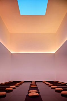 Gathered Sky (2012) by James Turrell -- A Turrell Skyspace is a specifically proportioned chamber with an aperture in the ceiling open to the sky. Skyspaces can be autonomous structures or integrated into existing architecture. The aperture can be round, ovular or square. Credit: Photo: Ben McMillan
