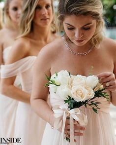 """Bridesmaids carried bundles of pearl roses and tulips accented with foliage tied by ivory ribbons. #InsideWeddings #Bridesmaid #Bridesmaids…"""