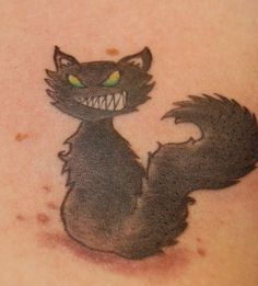 Cat Tattoos - Tattoos.net  this tattoo reminds me of my cat except for the mouth!