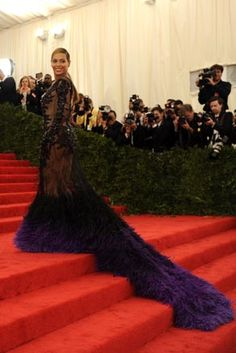 Beyoncé's long, feathery Givenchy gown draws attention at the Ball.