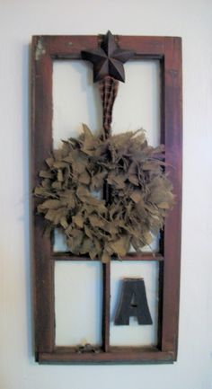 This might be one of my favorite creations.  Primitive window with iron star, burlap wreath and last name initial.  Love it.
