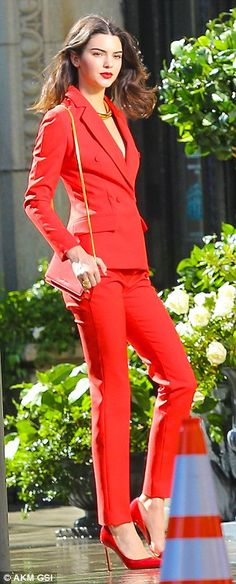 Red-dy for the runway! Kendall Jenner is smoking hot in rouge during a photo shoot on mother Kris Jenner's birthday