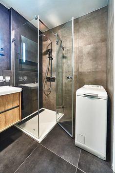Fotogalerie: Velkoformátové obklady dodávají koupelně na eleganci.