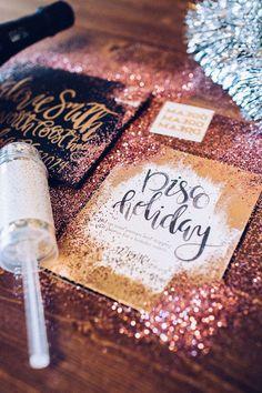 New Year's Eve party invitations - black + gold glitter invitations {Courtesy of Glitter Guide}