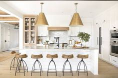 Modern Kitchen Interior This Chic Home in Minnesota Is Making Our Heads Spin - When it comes to modern traditional fusion, this Minnesota home nails it. Step inside and see how the designer Bria Hammel transformed this interior. Farmhouse Style Kitchen, Modern Farmhouse Kitchens, Home Decor Kitchen, New Kitchen, Cool Kitchens, Kitchen Ideas, Kitchen Island, Awesome Kitchen, Luxury Kitchens