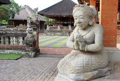"""Balinese people often greet each other with their palms touching in prayer position. This statue welcomed visitor at the """"Pura Puseh"""" in Batuan, Gianyar."""