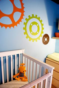 The gears and cogs on the wall are perfect ... I'm also digging the wall color :)