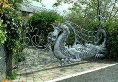 ۩ Splendid Dragon gate into a property on the approaching Fishguard: another piece of work by the local blacksmith Eifion Thomas. Garden Gates, Garden Art, Fence Gate, Fences, California Garden, Year Of The Dragon, Portal, Dragon Pictures, Entry Gates