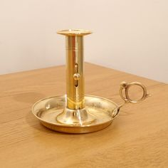 Vintage solid brass push up candle stick / candle holder / chamberstick by UKAmobile on Etsy