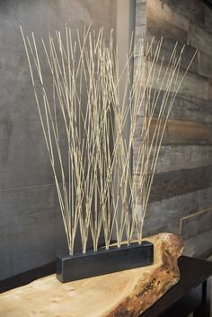 This modern Zen accessory by Susie Frazier adds style to any dining room, hotel lobby or spa. Handmade from blackened steel, this original centerpiece design features several holes on top for changing out dried grasses and plant stalks.