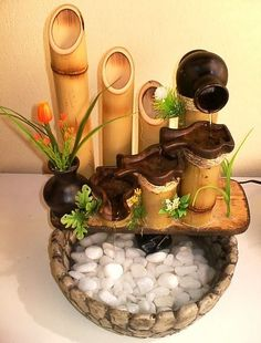 See on this pin Homemade Water Fountains, Indoor Water Fountains, Indoor Fountain, Garden Fountains, Table Fountain, Diy Fountain, Bamboo Water Fountain, Decoration, Art Decor