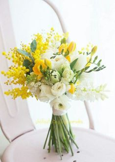 Hand Tied Wedding Bouquet Comprised Of: White Ranunculus, White Freesia, Yellow Freesia, Yellow Mimosa Flower #weddingflowers