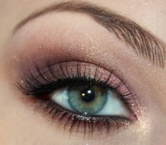 pretty makeup for hazel eyes. light purple across lid, darker purple/brown in crease, gold highlight in middle of lid and at corner, brown underneath eyes, black or dark green eyeliner in waterline and on top lid close to lashes