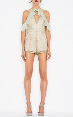 This **Alice McCall** Your Disco Needs You playsuit features asymmetric cold shoulders with ruffle detail, embellished transparent overlay, and sleeveless design.
