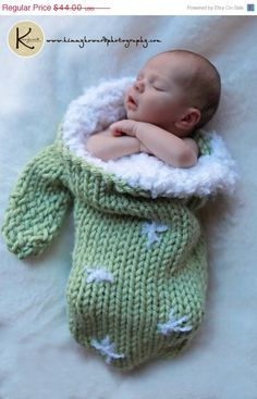 How stinkin' cute! This woman makes large mittens for newborn babies to fit in. :D