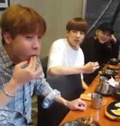 """I love how Yoongi is all happy while Jungkook looks like the words """"wTF DON'T EAT ME"""" are going through his mind"""