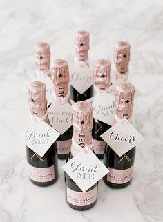 Mini champagne bottles. We have done this, so cute. #UniqueWeddingFavors
