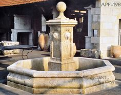 Antique Backyard Limestone Pool Fountain by Ancient Surfaces.212-461-0245www.AncientSurfaces.com