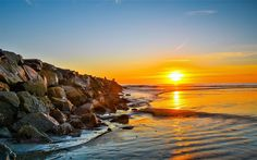 Download wallpapers sunset, coast, sea, stones, breakwater, seascape