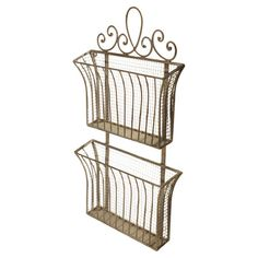 A charming addition to your entryway or kitchen pantry, this 2-tier wall organizer features a scrolling accent top and mesh design.