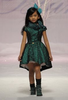 Emerald green stands out as a key colour at Pitti Bimbo this season, as seen here at the Miss Blumarine catwalk show.  Photograph copyright ofG. Giannoni