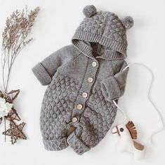 Baby Romper : Adorable knitted baby jumpsuit with chunky knit design, comfortable hood and cute pom pom ears. Knitted from a soft cotton blend material. Knitted Baby Outfits, Knitted Baby Clothes, Knitted Romper, Cute Baby Clothes, Baby Knits, Knit Baby Sweaters, Baby Boy Knitting Patterns, Baby Cardigan Knitting Pattern, Knitting For Kids