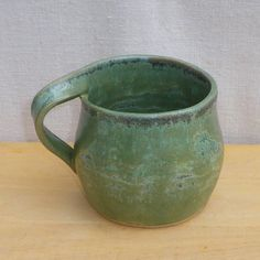 Left handed mug in stoneware hand thrown www.etsy.com/uk/listing/67541431
