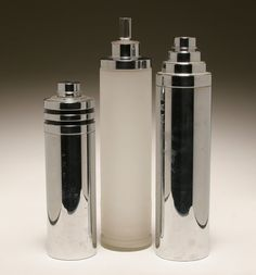 Three Art Deco chrome plated skyscraper cocktail shakers.