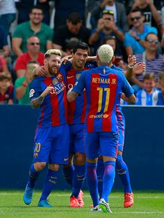 Lionel Messi celebrates scoring their opening goal with teammate Luis Suarez and…