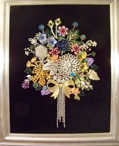 my bouquet of rhinestones created with vintage brooches, earrings, rhinestone and placed in a shadowbox frame.