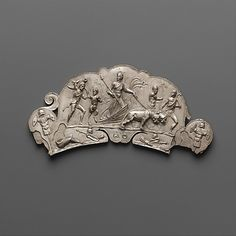 An ancient Roman handle depicts Dionysus's triumphal return from India, a scene symbolising triumph over death; Dionysus holds a symbolic thyrsus. (Metropolitan Museum of Art)