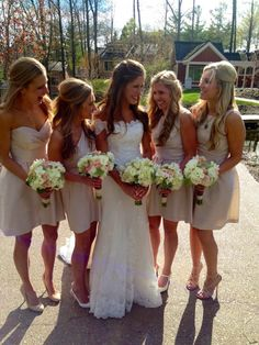 Beautiful bridesmaids. Bridal gown: Pronovias Bridesmaid gowns: Alfred Sung