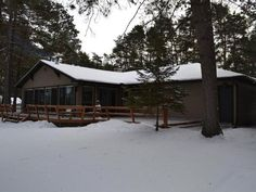 MLS # 146702 - NEW Listing! The focal point of this four season home will surely be the 29x14 ft. glass enclosed four season room. After a long day of fishing relax with your favorite beverage without the bugs bothering you. In the winter put a log in the wood stove and curl up with a good book. The roof siding windows and doors have all been updated. There is a one car attached garage and a newer two car detached garage plus a storage shed.